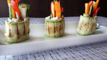 Zucchini rolls with cottage cheese and mixed vegetables
