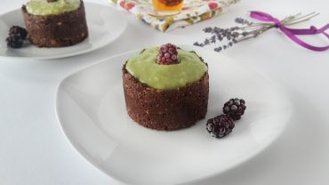 Raw vegan cake with walnuts and avocado cream