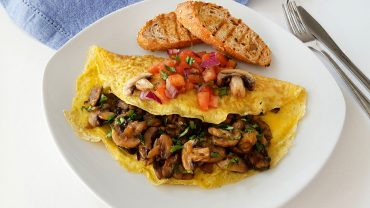 Omelette with mushrooms and tomato salsa